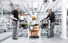LBR iisy pronounced easy co-robot and mechatronics in KUKA booth at Hannover Messe 2018